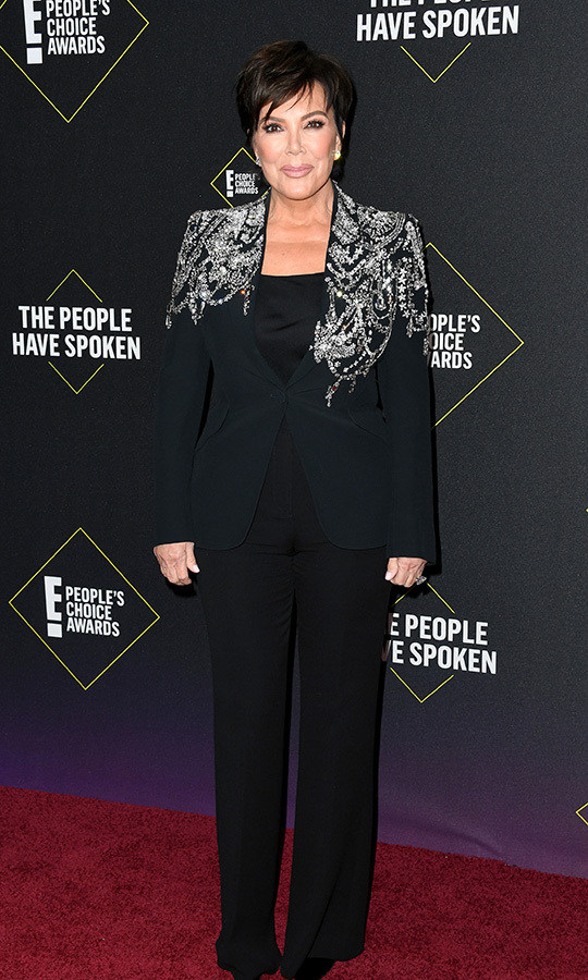"<strong><a href=""/tags/0/kris-jenner"">Kris Jenner</a></strong> chose a stunning black pantsuit with silver detailing on its shoulders. 