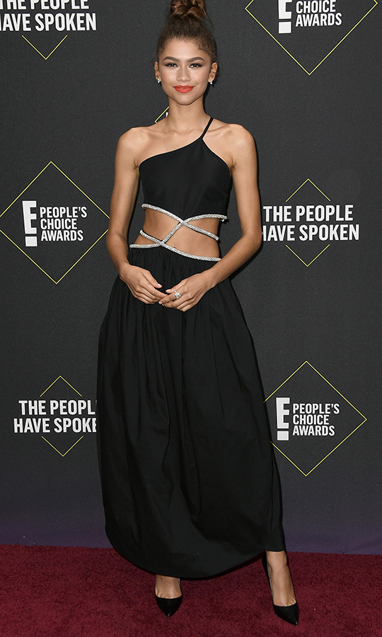 "Rising star (and future fashion icon) <strong><a href=""/tags/0/zendaya"">Zendaya</a></strong> chose a stunning black dress with a one-shoulder halter top and unique silver cutouts. 