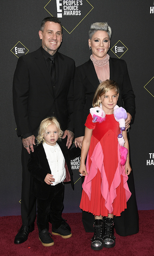 "<strong><A href=""/tags/0/pink"">Pink</a></strong> and <strong><a href=""/tags/0/carey-hart"">Carey Hart</a></strong> brought their adorable kids to the show! <strnog>Willow</strong> wore an outfit her mom would love to rock on stage, and came dressed in black studded boots, a red-and-pink dress and a unicorn wrap! Little <strong>Jameson</strong> looked adorable in chunky black shoes and a black-and-white ensemble.