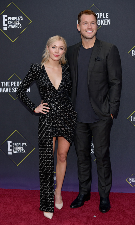 "<i><strong><a href=""/tags/0/the-bachelor"">The Bachelor</a></i></strong>'s <strong>Colton Underwood</strong> and <Strong>Cassie Randolph</strong> looked happy and in love on the red carpet. Cassie opted for a black dress with silver sequins that had a unique cut on its right side. 