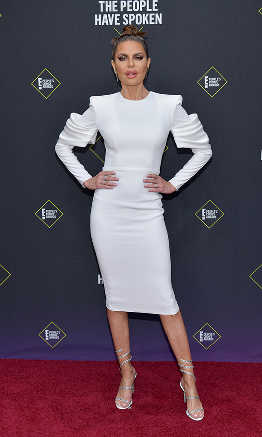"<strong><a href=""/tags/0/lisa-rina"">Lisa Rinna</strong></a> showed why she's been a style icon for decades with this gorgeous white dress with unqiue ruffles on its long sleeves.