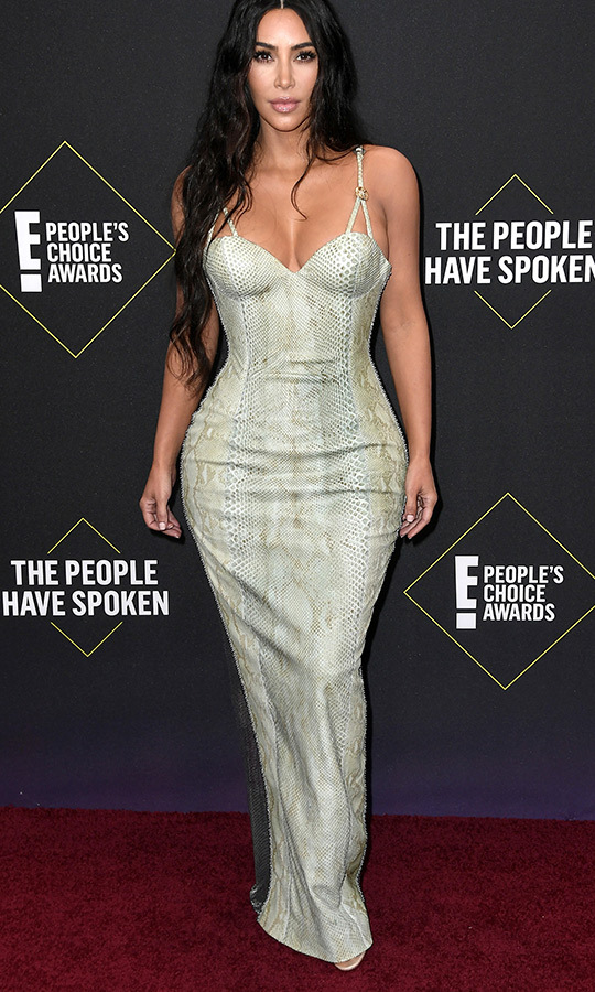 "<Strong><a href=""/tags/0/kim-kardashian"">Kim Kardashian</a></strong> opted for a unique light-green snakeskin-patterned dress. 