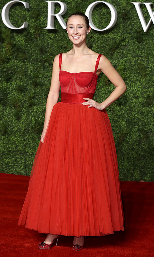 "<strong>Erin Doherty</strong>, who plays <Strong><a href=""/tags/0/princess-anne"">Princess Anne</a></strong>, completely stole the show with this look! She looked incredible in this red <Strong><a href=""/tags/0/dolce-and-gabbana"">Dolce & Gabbana</a></strong> dress with a structured, sleeveless bustier and a sweetheart neckline. She paired it with ruby red heels.
