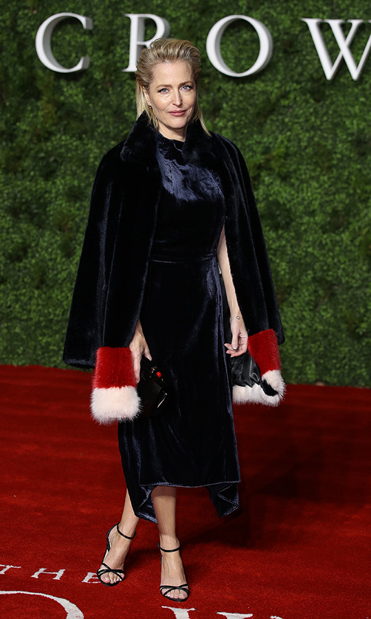 "<strong><a href=""/tags/0/gillian-anderson"">Gillian Anderson</a></strong>, who will play late former UK Prime Minister <strong>Margaret Thatcher</strong> in Season 4, looked incredible in a navy velvet look, which she paired with a matching overcoat with red and white fur trim.
