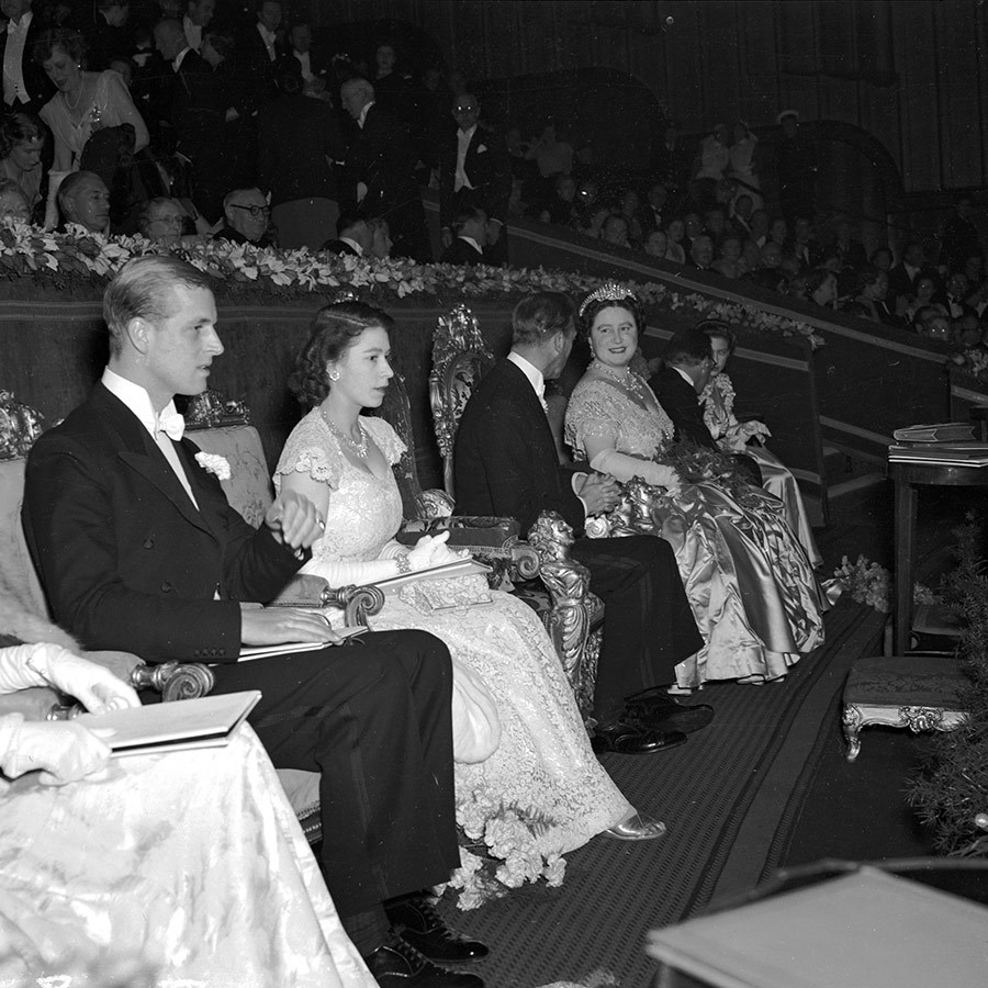 "The newlyweds spent a lot of 1948 in the UK as well, such as this night out to the premiere of <i>Hamlet</i> with George VI (second right) and the <strong><a href=""/tags/0/queen-mother"">Queen Mother</a></strong>.