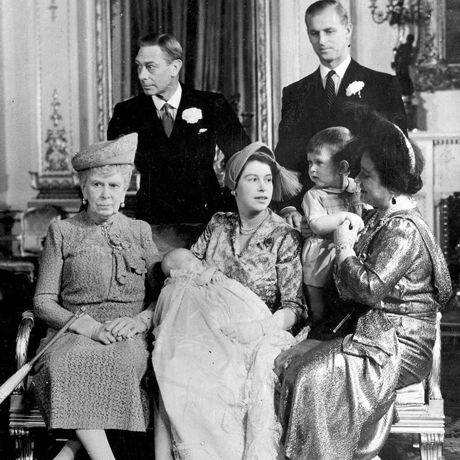"The next year brought the birth of <strong><a href=""/tags/0/princess-anne"">Princess Anne</a></strong> (in the then-princess's lap, sleeping soundly) and her christening that November, which was attended by her great-grandmother <strong>Mary of Teck</strong> (far left) along with George VI (second left) and the Queen Mother (holding Charles at right).