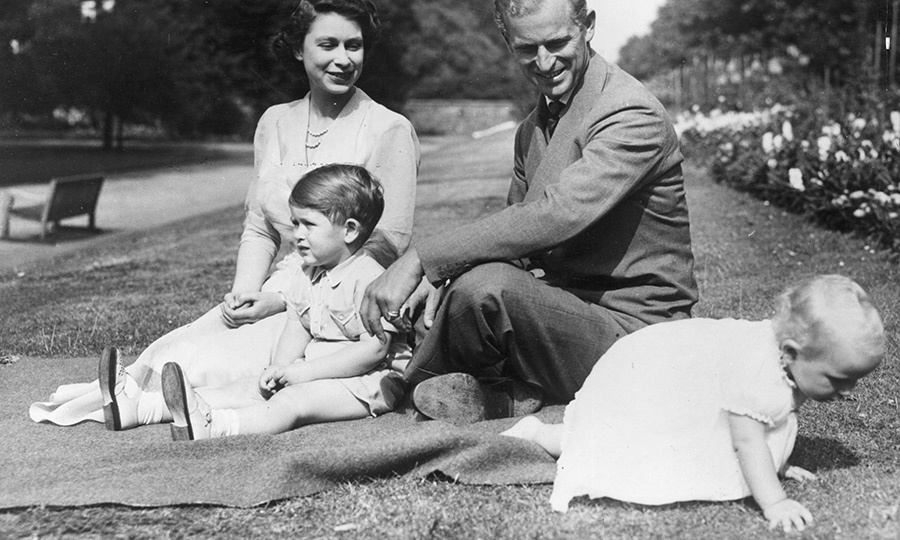In 1951, the couple moved back to London, where they again lived full time, making Clarence House their home. They remodelled it while their children were very young. This sweet photo was taken in the gardens at the home.