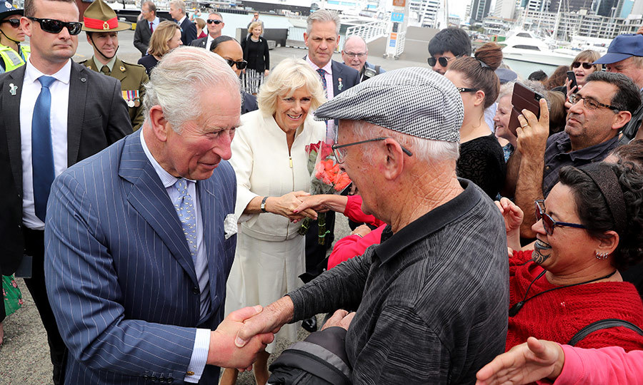 While there, he met back up with Camilla, and the two greeted members of the public who were waiting to say hello.