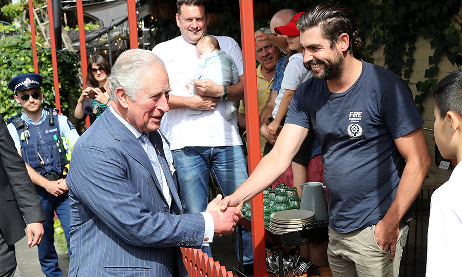 Charles continued greeting members of the public after the tea.