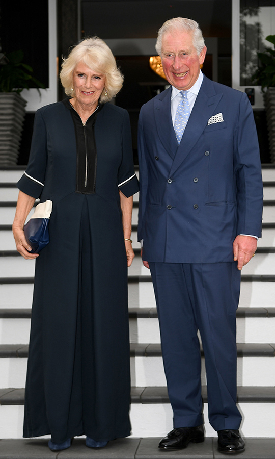 Charles has really been wearing a lot of blue on this tour! Camilla looked fantastic in a black dress with white accents, which she paired with a black-and-white purse.