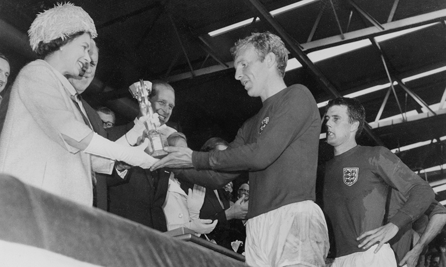 The Queen and Philip were on hand to present the Jules Rime Cup to England as they won the World Cup of soccer in 1966.