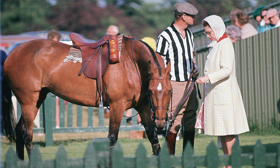 The Queen and Philip have always been united by shared passions, like polo. Here in 1973, Philip dresses as an umpire at a polo match while Her Majesty attends to a horse. 