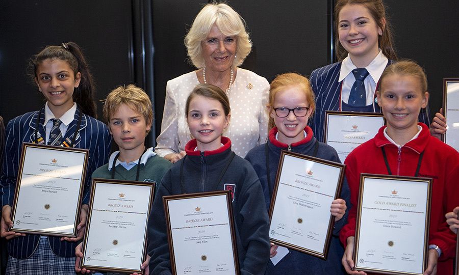 The Duchess of Cornwall also posed with several finalists in the Queen's Commonwealth Essay Competition.