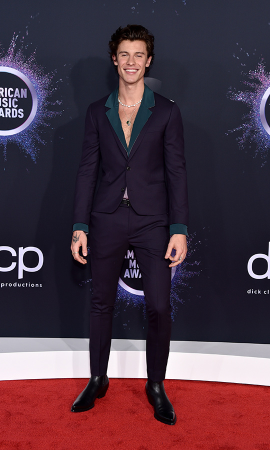 "<strong><a href=""/tags/0/shawn-mendes"">Shawn Mendes</a></strong> looked classy and edgy at once as he opted for no shirt under his jacket!