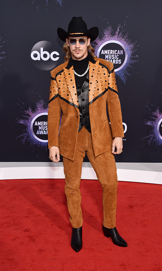 "Yee haw! <strong><a href=""/tags/0/diplo"">Diplo</a></strong> has worn plenty of cowboy looks on red carpets this year, and he continued that theme at the AMAs.