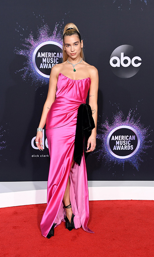 "<strong><a href=""/tags/0/dua-lipa"">Dua Lipa</a></strong> chose a hot pink look, which she paired with silver accessories.