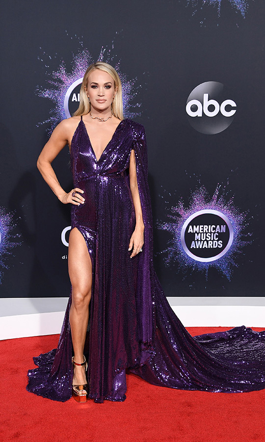 "WOW! <strong><a href=""/tags/0/carrie-underwood"">Carrie Underwood</strong></a> was not messing around with this incredible purple sequinned gown that showed off her right leg. 