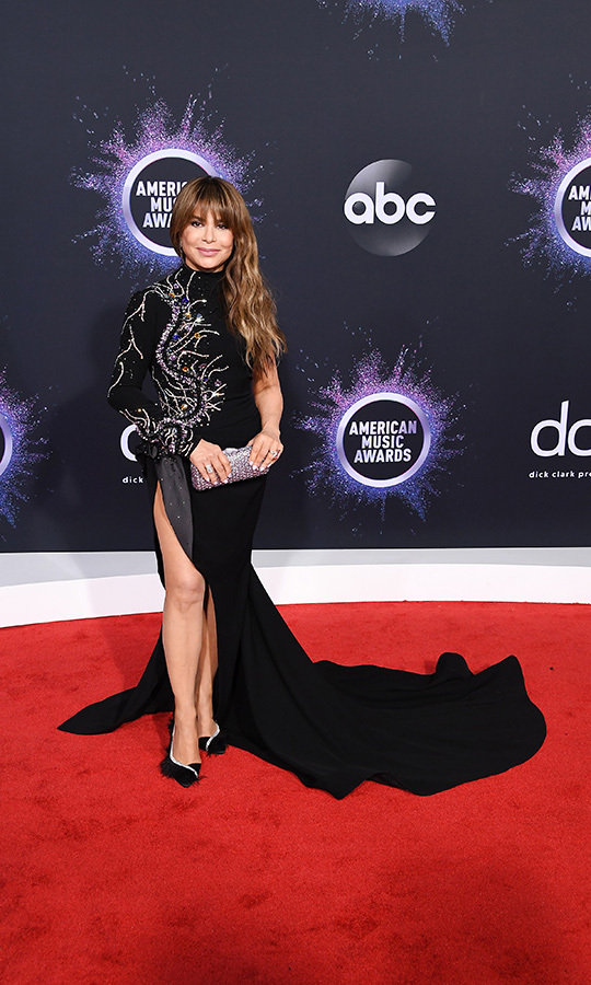 "<strong><a href=""/tags/0/paula-abdul"">Paula Abdul</a></strong> looked incredible in a black gown with a thigh-high slit that featured intricate silver detailing resembling both a tree and a dragon.