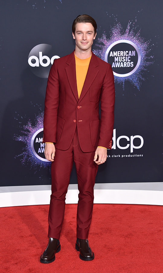 "<strong><a href=""/tags/0/patrick-schwarzenegger"">Patrick Schwarzenegger</a></strong> is terminating us with this look! Arnold's son looked awesome in a crimson suit with an orange shirt underneath.