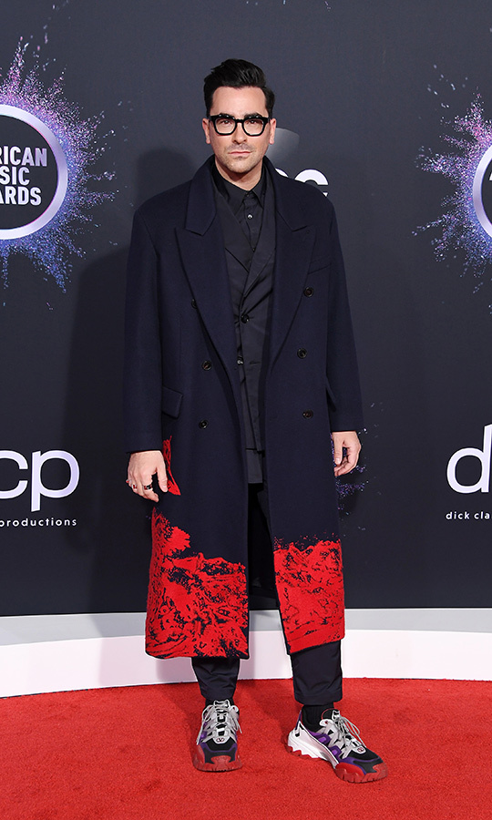 "<strong><a href=""/tags/0/dan-levy"">Dan Levy</a></strong> did not come to play, despite the shoes! The <i><strong><a href=""/tags/0/schitts-creek"">Schitt's Creek</a></strong> star matched his incredible full-length coat with his runners in a look that's very unique and we hope to see him wearing more soon.