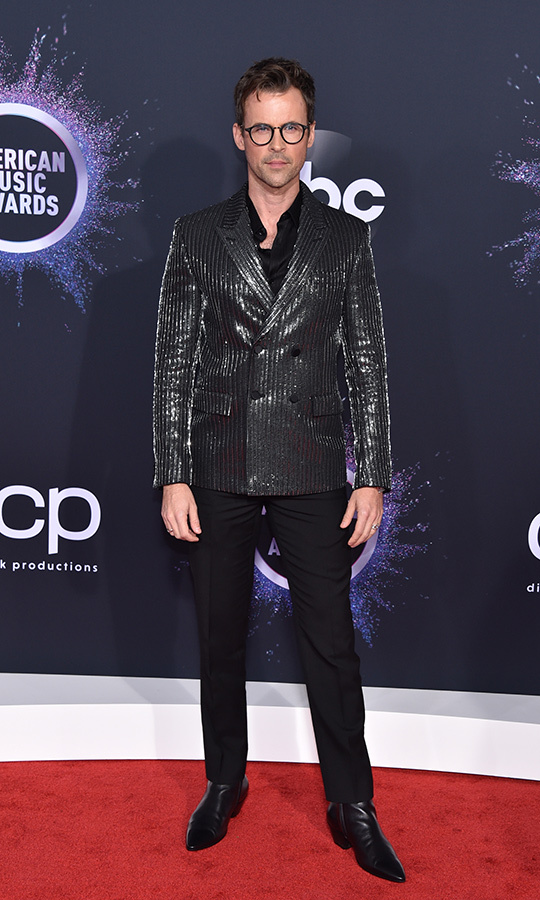 "<Strong><a href=""/tags/0/brad-goreski"">Brad Goreski</a></strong> got right in on the red carpet trend toward sparkling, shimmering design, sporting a snazzy silver jacket on top of his all-black ensemble.