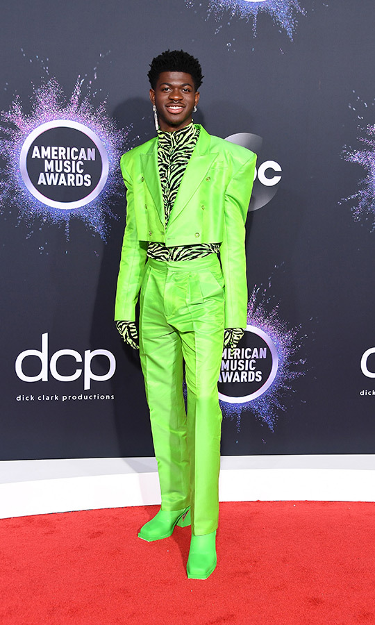 "<strong><a href=""/tags/0/lil-nas-x"">Lil Nas X</a></strong> made a strong statement on the red carpet, rocking a neon green tuxedo, matching goots and a zebra-print shirt underneath. 