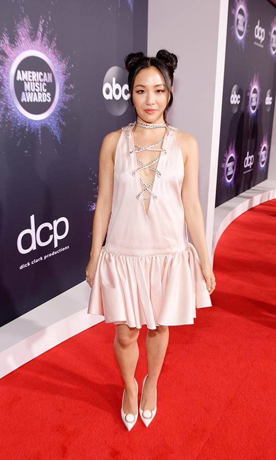 "<strong><a href=""/tags/0/constance-wu"">Constance Wu</a></strong> looked gorgeous in a blush gown with a v-neckline that was held together with silver strands. 