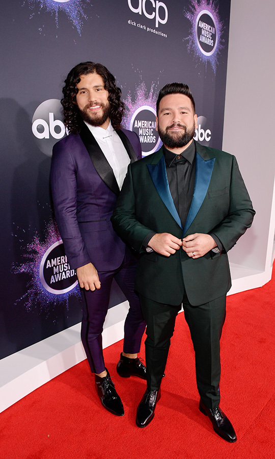 "<strong><a href=""/tags/0/dan-and-shay"">Dan + Shay</a></strong> looked dapper in purple-and-black and green-and-blue ensembles.