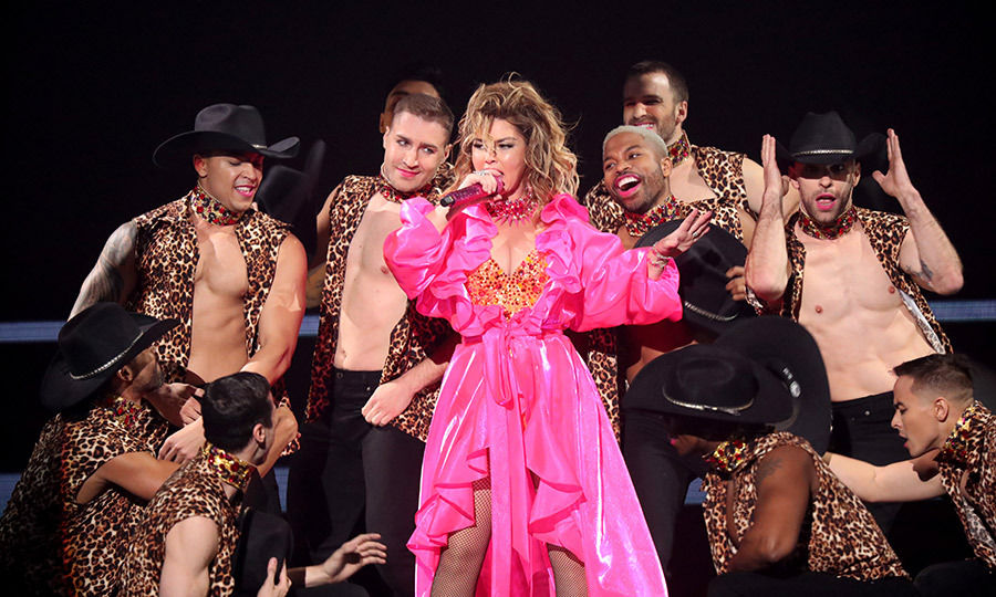 "She then launched full-on into her hits, including ""Still the One"" and ""Any Man of Mine."" At that point, she was joined on stage by a troupe of male dancers, who looked awesome in open cheetah-print vests and black pants topped off with cowboy hats. It was all very '90s! 