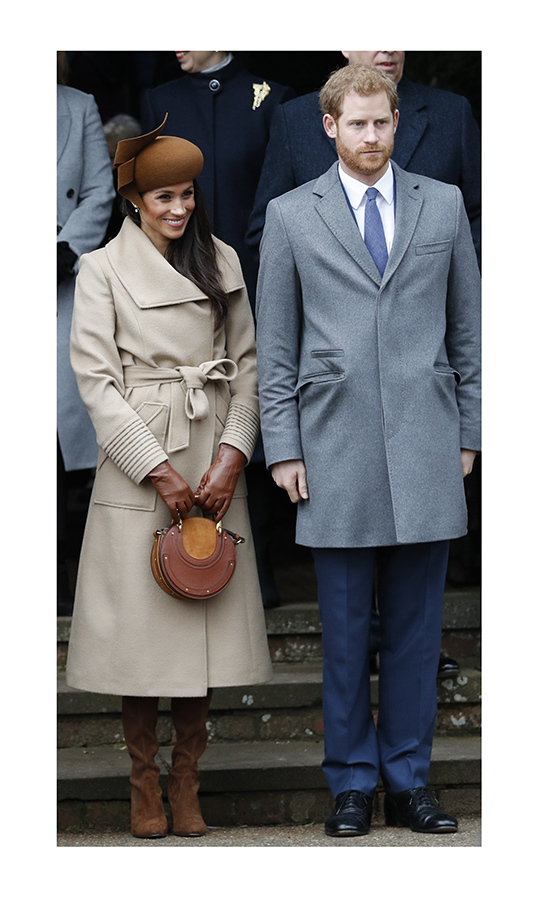 Meghan spent her first Sandringham outing in 2017 in a camel coat by <strong><a href=/tags/0/sentaler>Sentaler</a></strong>. She teamed it with a <strong><a href=/tags/0/philip-treacy>Philip Treacy</a></strong> hat and a <strong><a href=/tags/0/chloe>Chloé</a></strong> bag. 