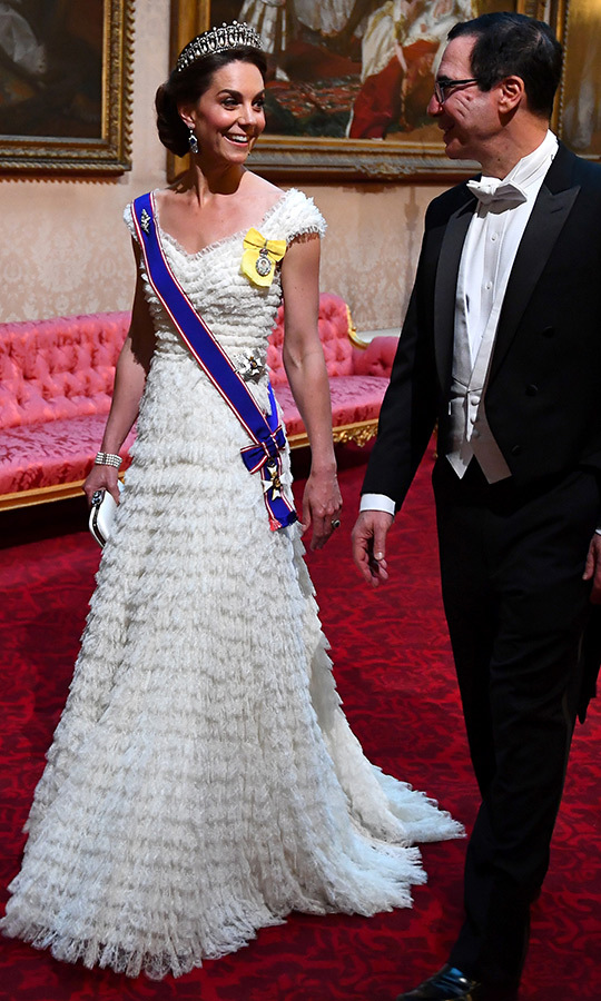 On June 4, Kate looked stunning in this incredible white <strong><a href=/tags/0/alexander-mcqueen>Alexander McQueen</a></strong> at a state banquet held at Buckingham Palace in honour of US President <a href=/tags/0/donald-trump><strong>Donald Trump</a></strong>'s visit to the UK. She paired it with the Cambridge Lover's Knot tiara and also wore the Queen Mother's diamond and sapphire fringe earrings. 