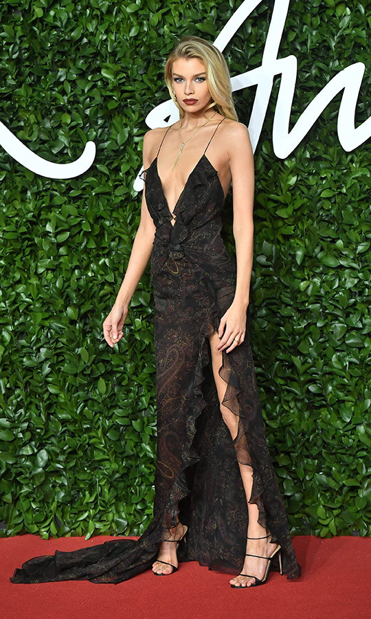 December? Cold weather? What are those? It was 2 degrees Celsius in London, but <strong><a href=/tags/0/stella-maxwell>Stella Maxwell</a></strong> was determined to heat things up with this incredible translucent black dress with frills and a deep V-neck.
