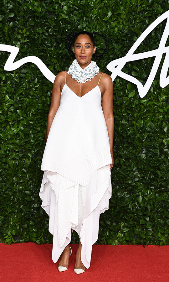 Host <strong><a href=tags/0/tracee-ellis-ross>Tracee Ellis Ross</a></strong> looked incredible in a white spaghetti-strap layered dress with matching heels and a gorgeous blue-and-white ruffled scarf on the red carpet.