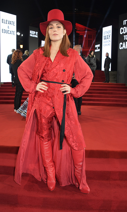 Swedish actress <strong>Noomi Rapace</i>, known for her work in <i>The Girl with the Dragon Tattoo</i> series, chose an all-red ensemble, which she paired with a massive red tophat and knee-high red leather boots.