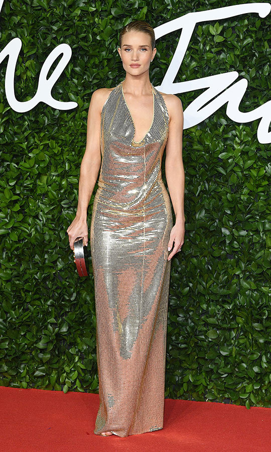 <strong><a href=/tags/0/rosie-huntingdon-whiteley>Rosie Huntington-Whiteley</a></strong> looked incredible in a silver sequinned gown, which she accessorized with a matching clutch.