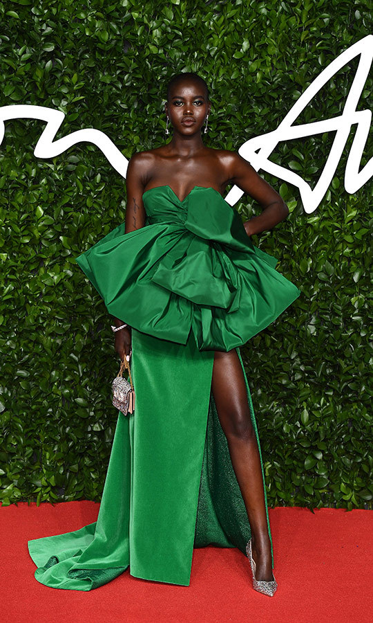 <strong><a href=/tags/0/adut-akech>Adut Akech</a></strong> looked stunning in this very unique green velvet dress with a ruffled bodice.