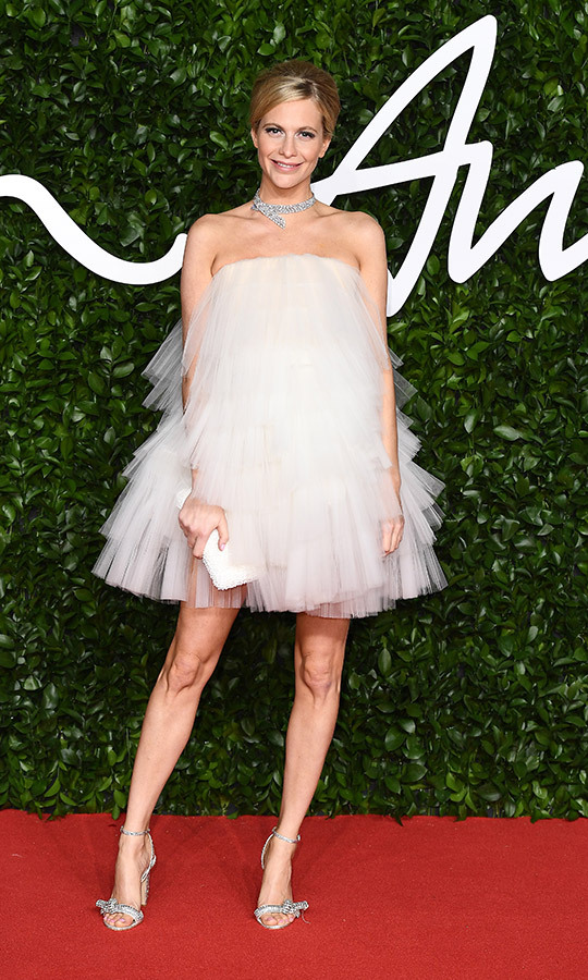 <strong><a href=/tags/0/poppy-delevingne>Poppy Delevingne</a></strong> looked beautiful in this white ruffled strapless mini gown.