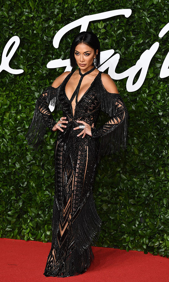This look is so <strong><a href=/tags/0/nicole-scherzinger>Nicole Scherzinger</a></strong>! The pop star wowed in this jaw-dropping black dress with unique cutouts all.over.it.