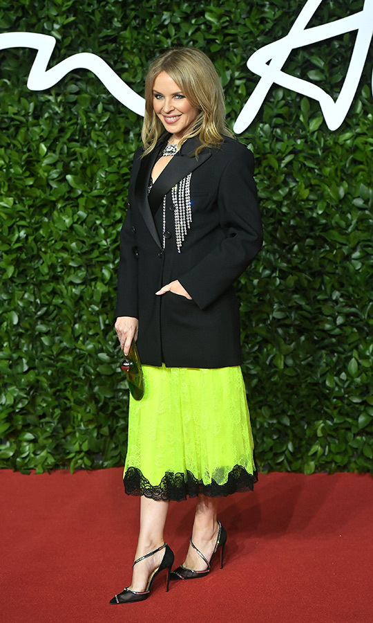 <strong><a href=/tags/0/kylie-minogue>Kylie Minogue</a></strong> looked like the total legend she is in this bright neon green skirt, which she paired with a black studded blazer.