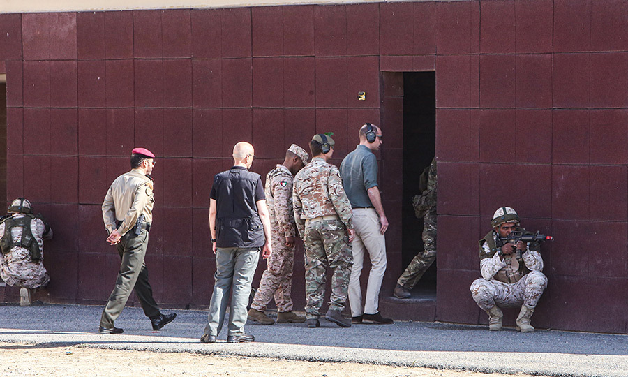 William put on protective earwear and headed into a building on the base. 