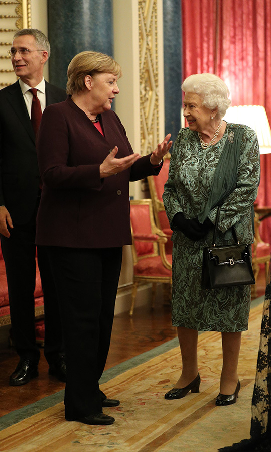 Her Majesty was also keen to get some time in with Angela.