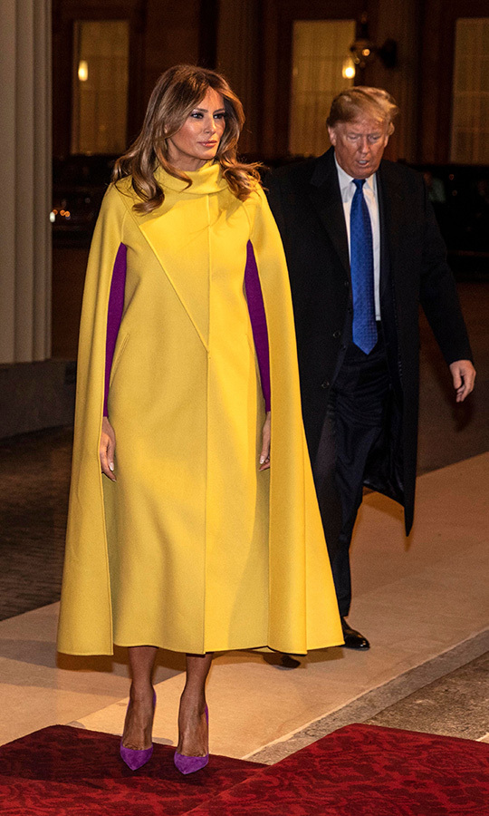 Here's a closer look at Melania's unique yellow and purple <strong><a href=/tags/0/valentino>Valentino</a></strong> cape dress.