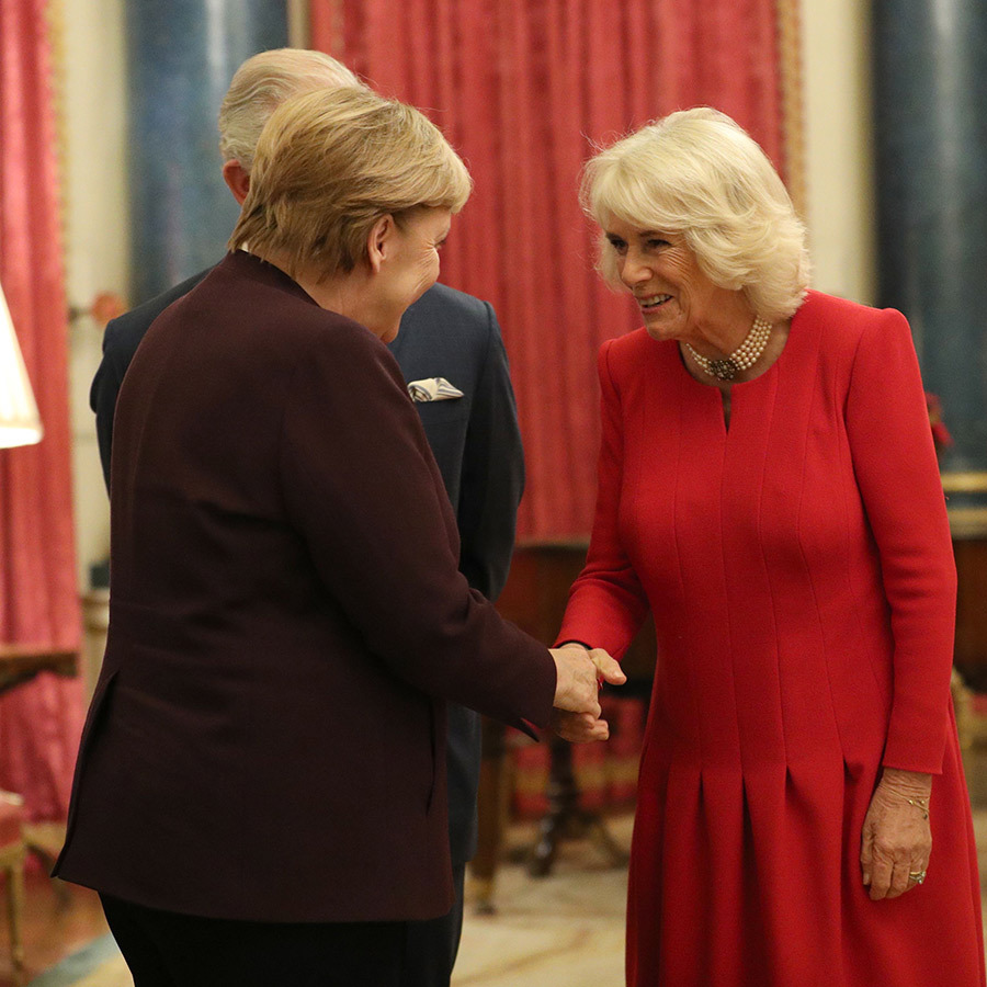 Camilla and Charles looked very pleased to see Angela.
