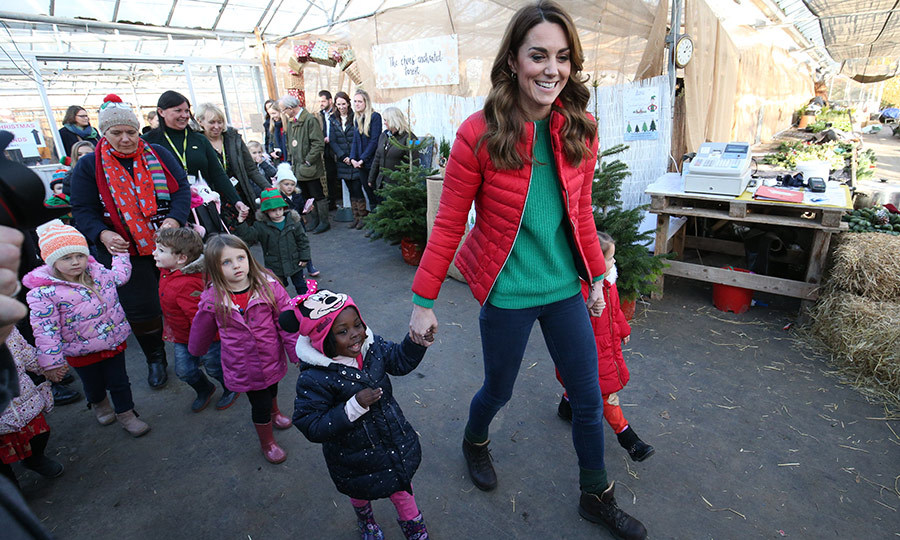 Of course, Santa needs elves to make Christmas happen, so Kate eagerly joined the children so they could be her special helpers! The mom of three looked thrilled as she took two kids' hands and headed into the farm.