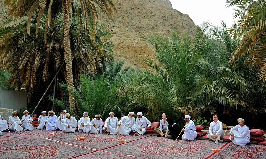 They sat down in the village square in a circle, and William respectfully took off his shoes.