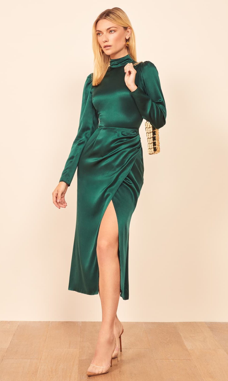 "<p>The high neckline of this silky style is juxtaposed with a midi skirt with leg-revealing slit. The beautiful dress also has a surprise keyhole cutout on the back!<p>Reformation Carmelina dress, $460, <a href=""https://www.thereformation.com/products/carmelina-dress?color=Emerald&via=Z2lkOi8vcmVmb3JtYXRpb24td2VibGluYy9Xb3JrYXJlYTo6Q2F0YWxvZzo6Q2F0ZWdvcnkvNWE2YWRmZDJmOTJlYTExNmNmMDRlOWM2"">Reformation</a</p><p><a href=""https://www.zara.com/ca/en/textured-dress-with-belt-p01165642.html?v1=30360143&v2=1281625"" target=""_blank""></a><a href=""https://www2.hm.com/en_ca/productpage.0803990001.html"" target=""_blank""></a>Screenshot via Reformation"