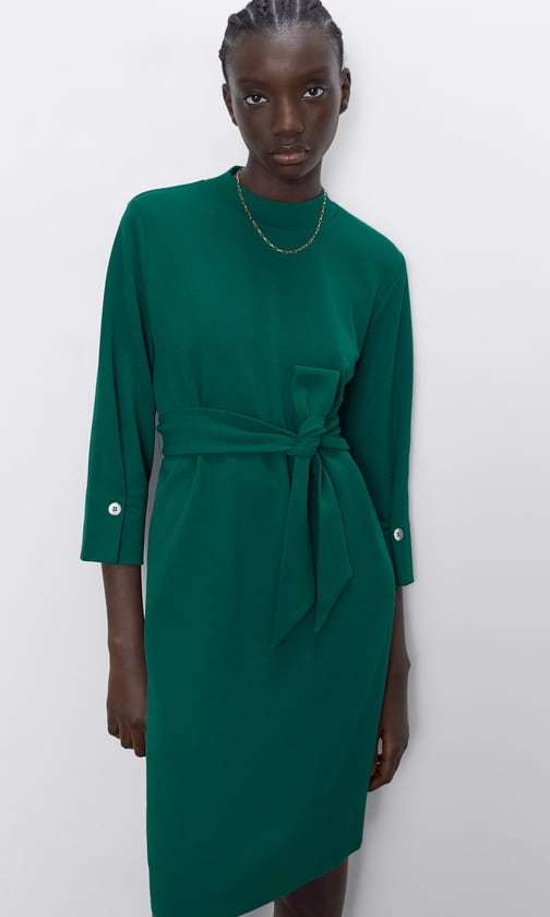 This budget-friendly dress has a regal finish thanks to the high rounded neckline and three-quarter-length sleeves with button cuffs. There's no need for a belt thanks to the fabric one!