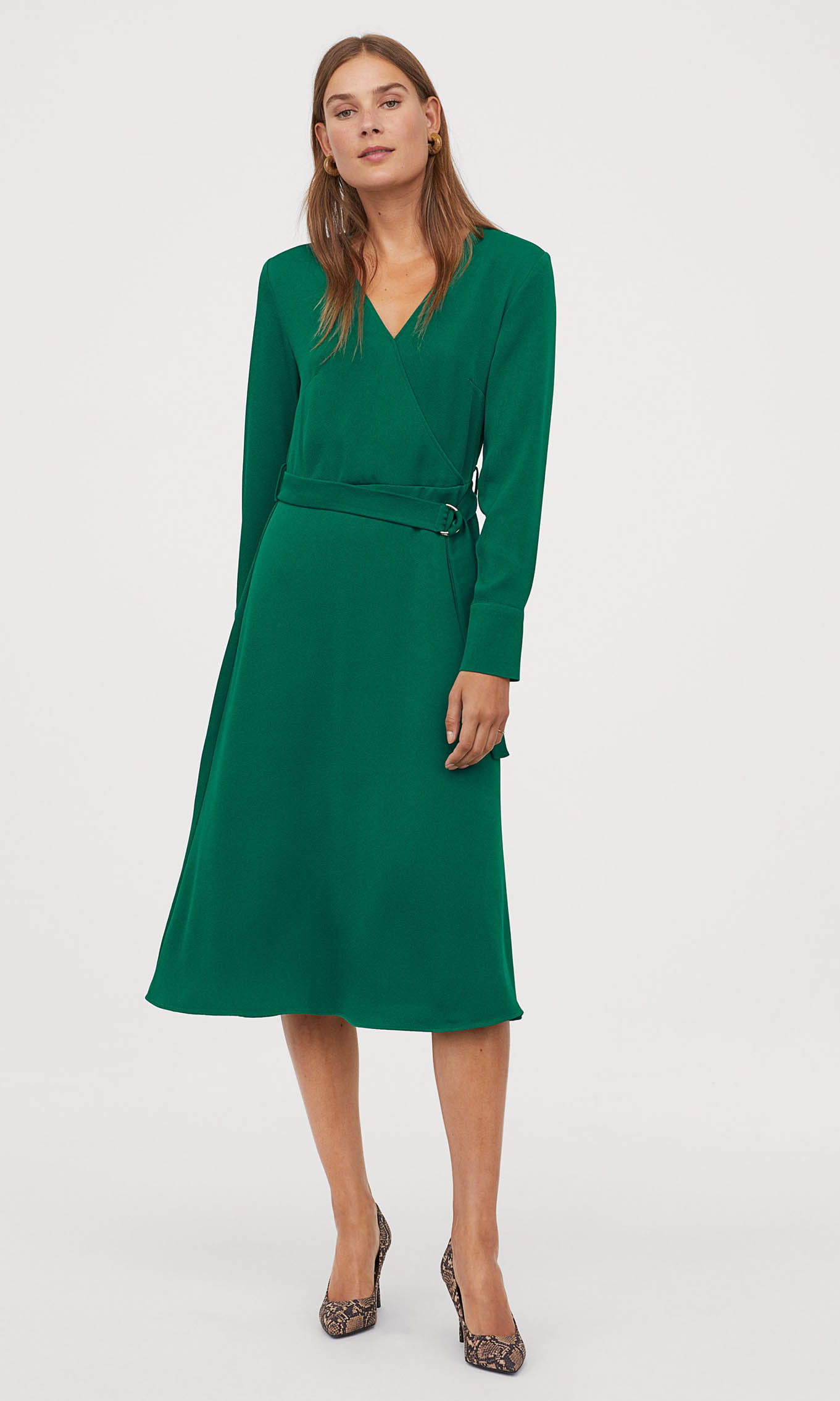 <p>This figure-flattering wrap dress can be dressed up for day or night. 