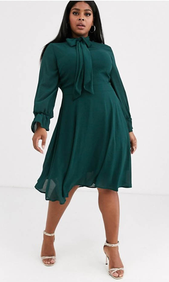 <p>The forest green frock will carry you from work to holiday parties thanks to its charming bow and prim silhouette. Pussy bow blouses are another signature of Kate's style, so this dress works nicely into that.
