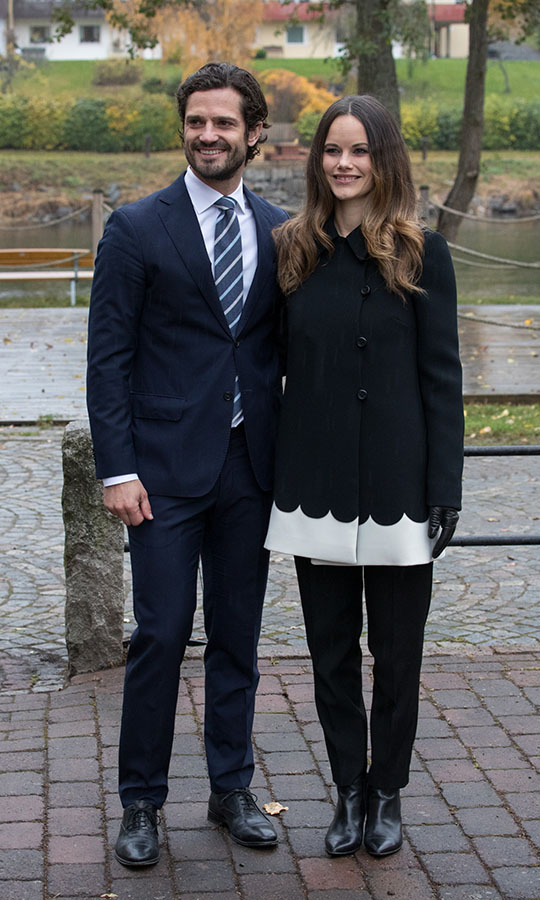 Joined by Prince Carl Philip, Princess Sofia displayed a unique take on a black coat during a visit to Varmland, Sweden on Oct. 21, 2016. Notice the scalloped detail and contrasting white hem.<p>Photo: © Luca Teuchmann/Getty Images